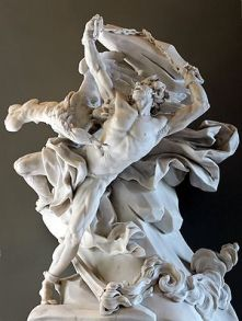 Prometheus chained and hanging from a cliff with a vulture attacking him, carvedin marble