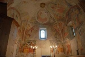 Sanctuary in San Gian in Celerina Switzerland, showing the old frescoes on the walls.