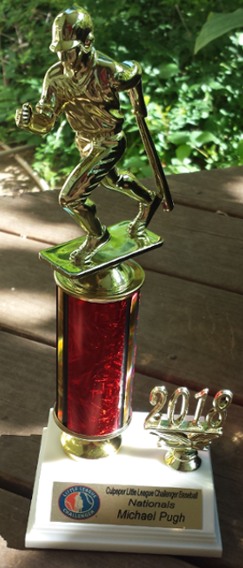 Baseball trophy with batter running