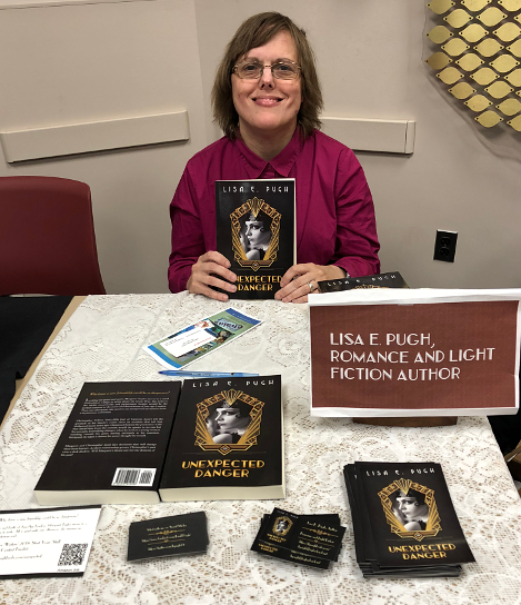 Me sitting at my table at the local author book event.